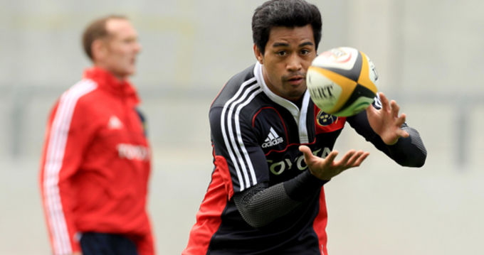 ifeimi Mafi in training with Munster A defence coach Ian Costello in the background