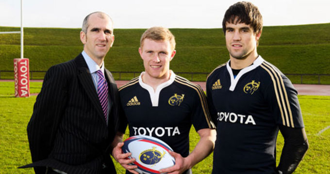 Tom Larkin, Marketing Manager of Magnet Networks pictured with Keith Earls and Conor Murray