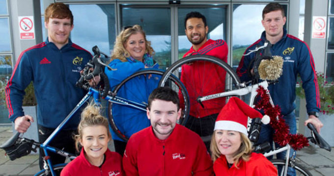Munster players Sean Dougall, Casey Laualala and Denis Hurley join Soprano Cara O'Sullivan and Red FM staff in launching the 2013 Christmas Cracker Cycle in aid of Marymount Hospice