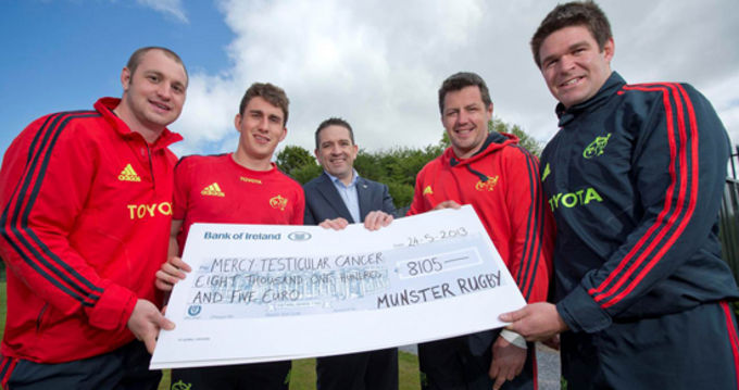 Johne Murphy, Ian Keatley, James Coughlan and Billy Holland present the cheque to Mercy Hospital Foundation's Chief Executive Micheàl Sheridan