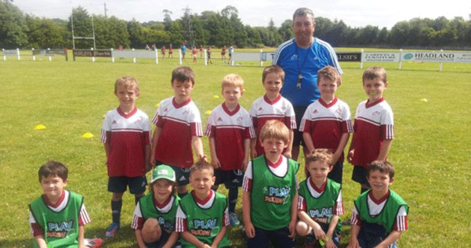 Summer Camp participants at Midleten RFC pictured with Munster Rugby Officer Finny O'Regan