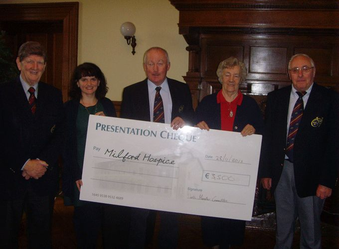 Gerry Moore and Christy Ryan of the Munster Branch present a cheque for 3,500 Euro to Milford Hospice