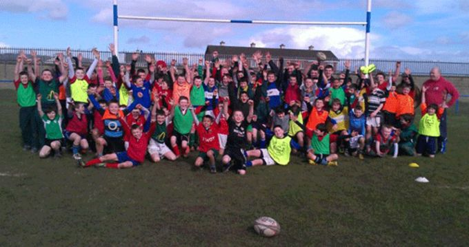 Players from JFK primary school at Thomond RFC