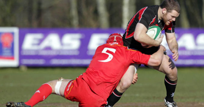 Ian Nagle puts in the tackle