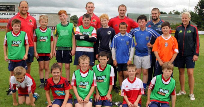 Munster players BJ Botha, Shane Buckley, Duncan Casey and Johne Murphy picuted with Summer Camp participants and Joy Neville, Ireland Grand Slam winner at Nenagh Ormond RFC