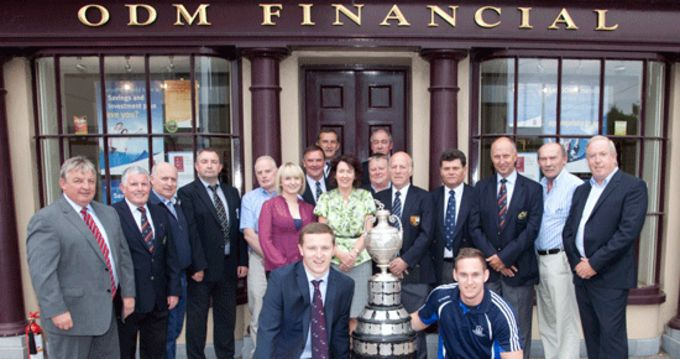 Staff of ODM Financial pictured outside their office in Bandon with Munster Senior Club representatives and Munster Rugby CEO Garrett Fitzgerald