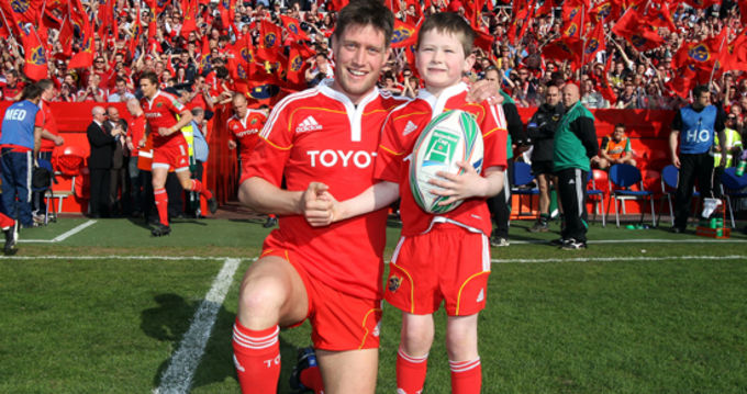 Munster Captain Ronan O'Gara with match-day team mascot Evan O'Connell