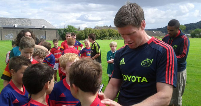 Ronan O'Gara and Simon Zebo sign autographs at CSN, Cork.