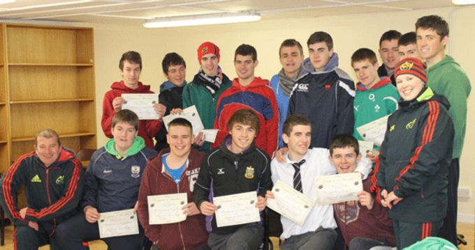PBC transition year students receive their participation certificates from Munster Rugby's Ray Gadsden and Amanda Greensmith.