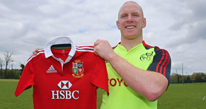 Paul O'Connell holds up a 2013 Lions jersey - not his, unless it shrank!