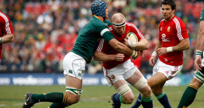 Lions Captain Paul O'Connell is tackled by South Africa's Juan Smith