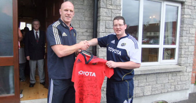 Six Counties: All as One - Paul O'Connell presents Munster fan and prize winner Mark Kennedy from Nenagh, Co Tipperary with his new signed adidas jersey
