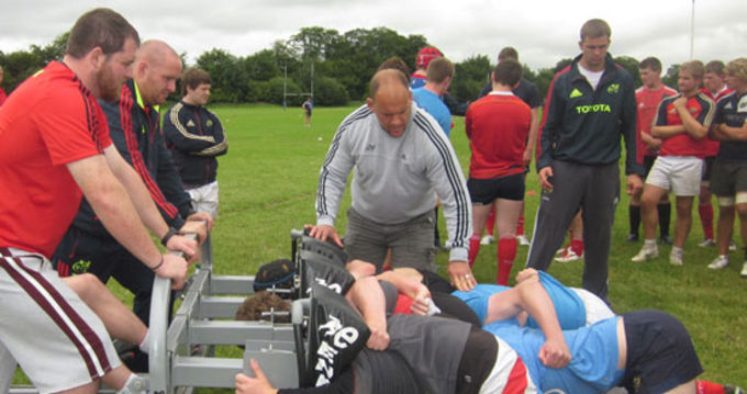 Scrum time - the underage players come together under the watchful eye of BJ Botha