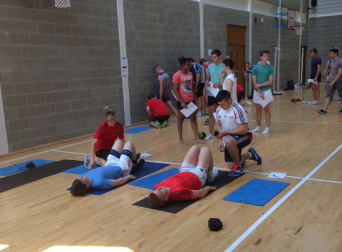 North Munster RDS players taking part in yesterday's one hour gym session at UL