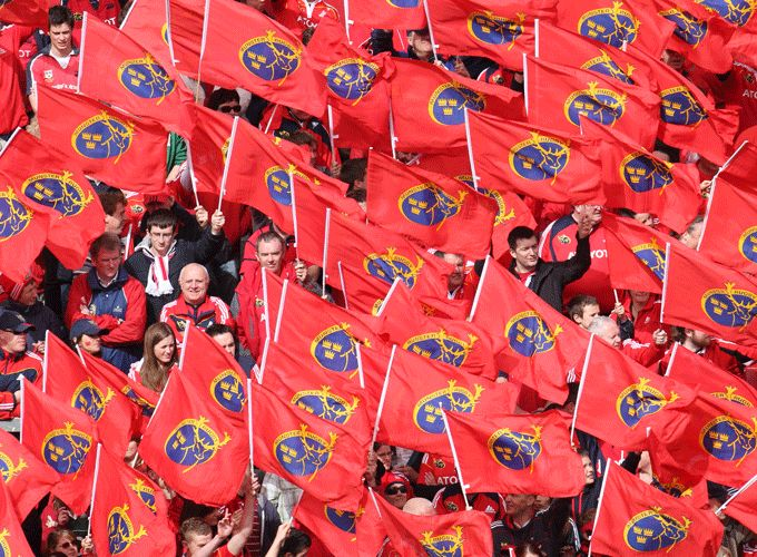 Red Army fly flags with pride.
