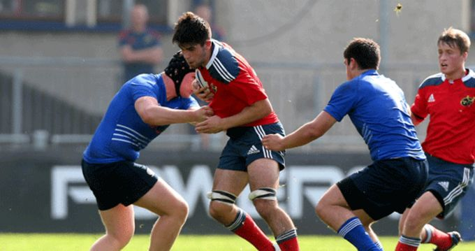 Munster's Robert Walsh from Waterpark RFC on the charge