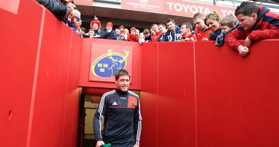 Ronan O'Gara enjoys the reception he receives as he heads out for the training session in Thomond Park