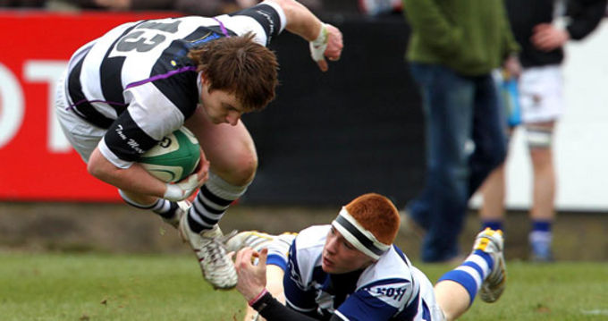 PBC's Rory Scannell breaks away from a tackle in the Munster Schools Senior Cup Final 2011