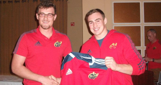 Tommy O'Donnell presents Munster 18 Clubs Captain Sean O'Leary with his Munster interprovincial jersey