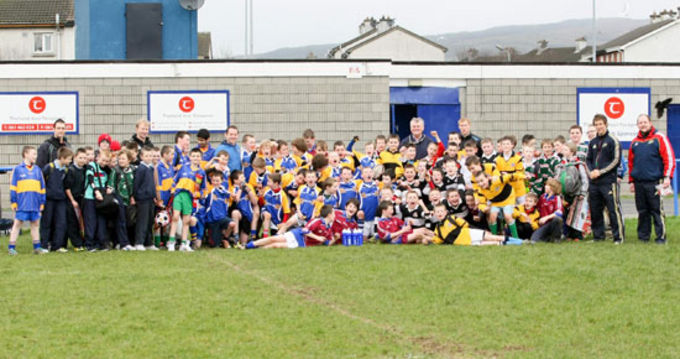 Students and Teachers who participated in the Schools Blitz at Thomond RFC pictured with Regeneration Assistant Director; Kieran Ryan and Munster staff
