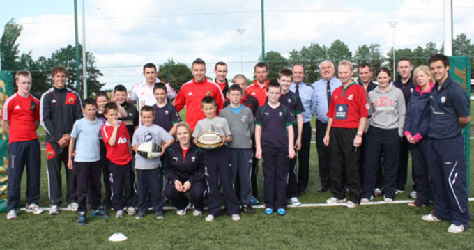 Munster players Felix Jones and Nial Ronan pictured with participants of the Garda diversion programme