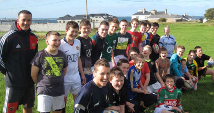 Community Rugby Officer Fiach O'Loughlin with Rugby Skills Day Participants at Spanish Point