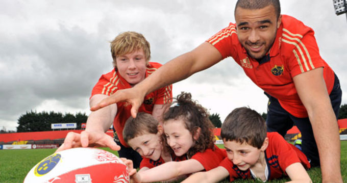 Munster Rugby's Danny Barnes and Simon Zebo pictured with Alison Ryan, Kevin Ferguson and David Ferguson at the launch of the 2012 Centra Munster Rugby Summer Camps