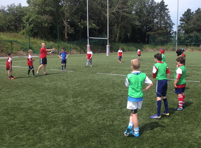 Boys and girls learining new rugby skills yesterday at Garryowen FC