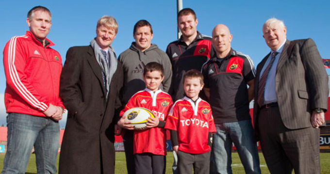 Brothers Tom and Ewan Kelly, Ray Kelly, Centra Marketing Director with Munster Players, James Coughlan, Donnacha Ryan and Peter Stringer, with Damon Urlich, Community Rugby Manager and Cyril Fitzgerald Munster Rugby President.