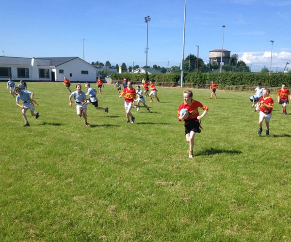 Boys and girls taking part in a rugby blitz day at Thurles RFC