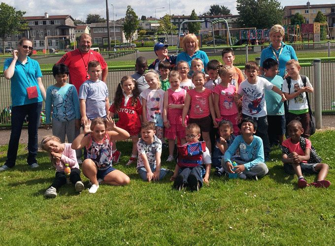 Ray Gadsden pictured with the children and their teachers at the Togher Resource Centre