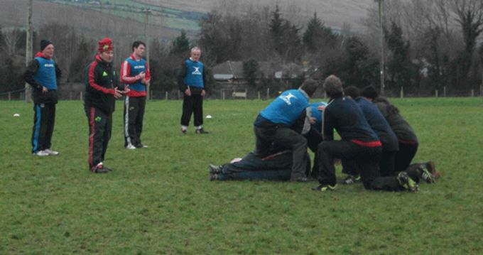Mini coaches take part in on pitch tutor sessions at Tralee RFC