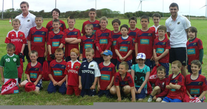 Munster Rugby's Troy Smith and Declan Cusack visit the Kilrush RFC Summer Camp