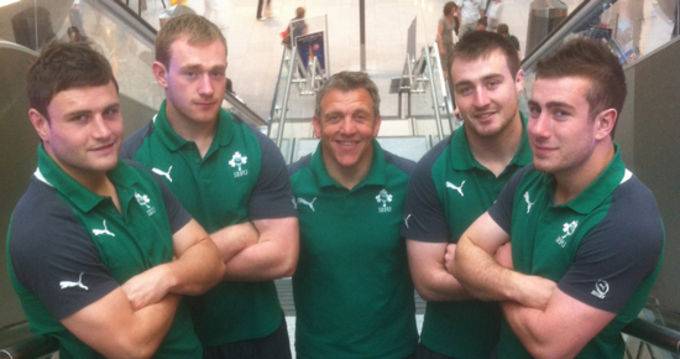 Munster and Ireland U20 players James Rael, Shane Buckley, Niall Scannell and JJ Hanrahan pictured at Dublin Airport with Ireland Backs Coach Greig Oliver (centre)