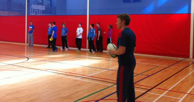 Munster Rugby's Feargal O'Callaghan presents the fundamental movement initiative to UCC students