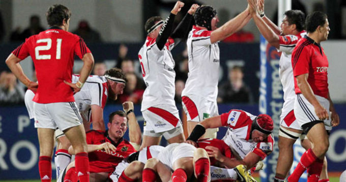 Ulster players celebrate at the final whistle in Ravenhill