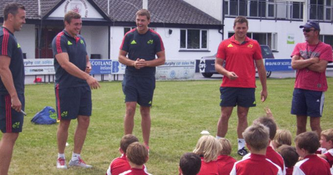Niall Ronan, Tommy O'Donell, Dave Foley and CJ Stander share a joke with the Summer Camp participants at Waterpark RFC