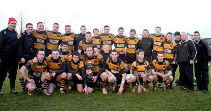The Young Munster U21s squad with the North Munster League trophy