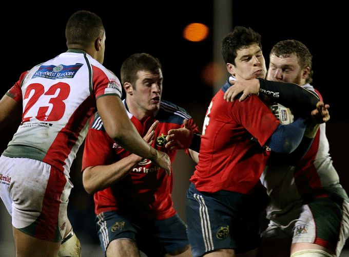 Munster's Alex Wootton is tackled in last December's B&I Cup clash with Plymouth Albion